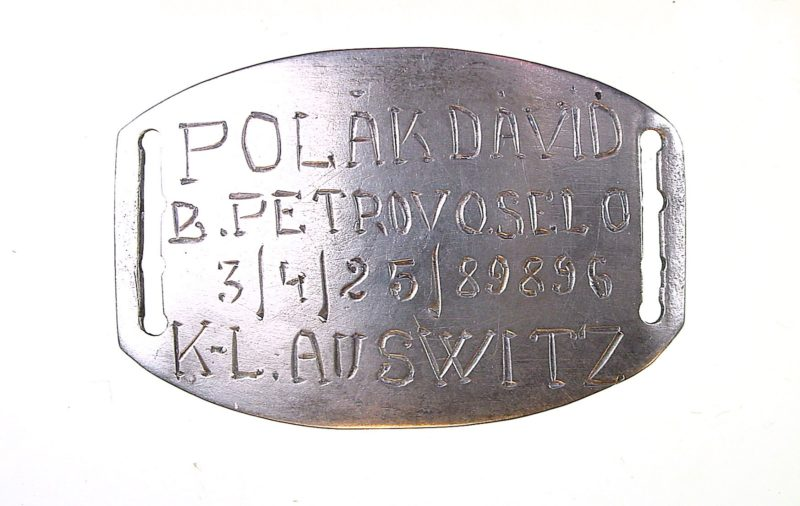 David Polak's bracelet plaque with the reversible number