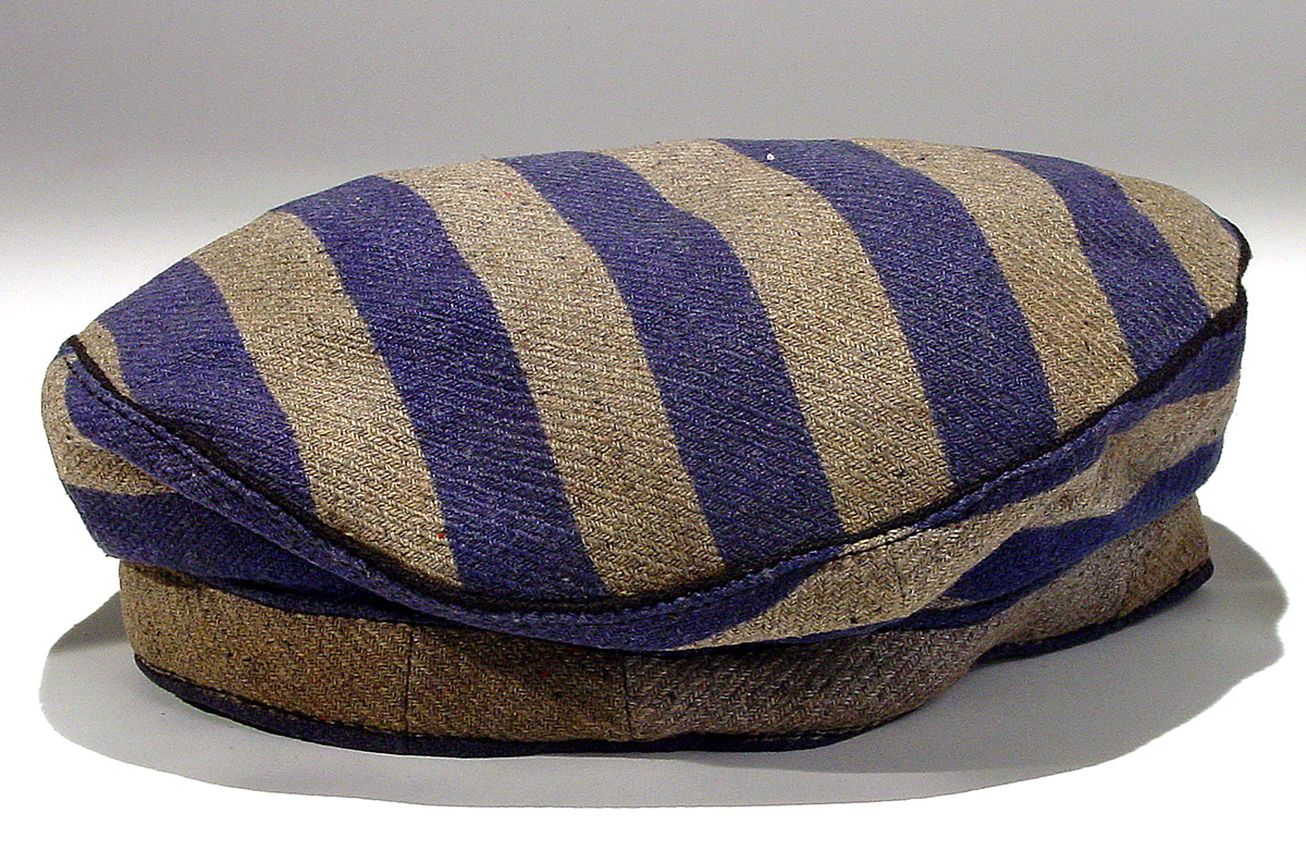 Concentration camp cap worn at Mauthausen by Sam Moneta Born in Bedzin, Poland, Sam Moneta was arrested in Poland in 1943, sent to Birkenau, then Gross-Rosen and Buchenwald. Due to overcrowding, he was transferred to Mauthausen and finally liberated. After liberation he returned to Poland, and immigrated to the United States in 1952 by way of Sweden and Canada. Gift of Sam Moneta