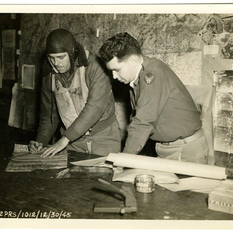 Capitan Lowitt briefing a pilot in Bari, Italy in December, 1945