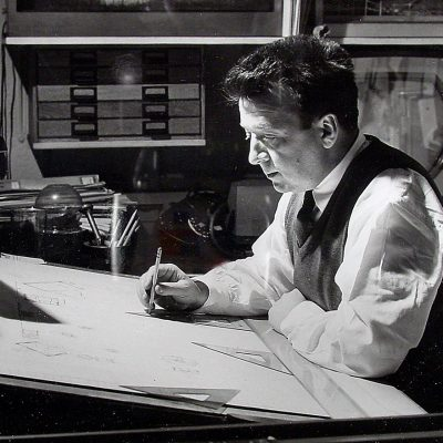Sam Leve at his drafting board, working on designs