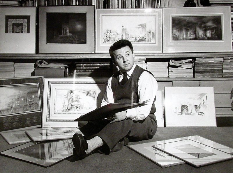 Sam Leve sitting on the floor surrounded by his designs for various theatrical productions, 1948.