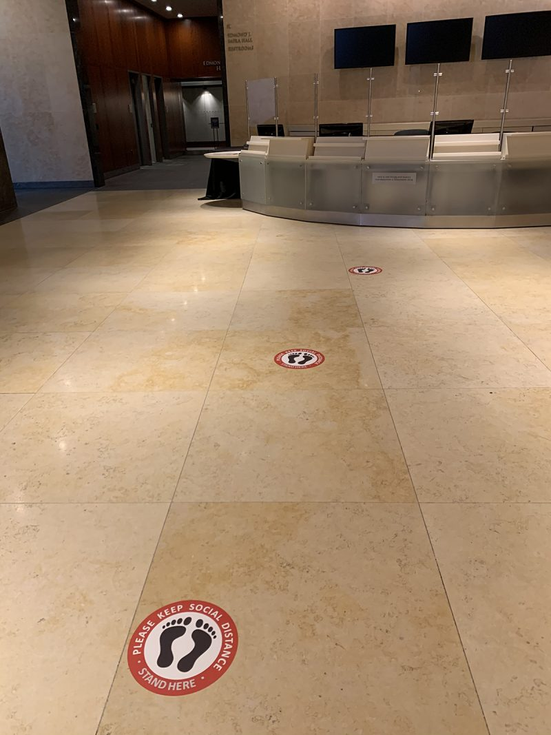 Museum lobby social distancing footsteps