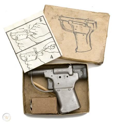 A Liberator pistol and accessories in its original box.