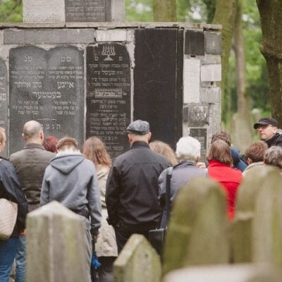 Members of the local community join historian Dr. Jacek Proszyk for a tour of the Jewish cemetery, November 2019.