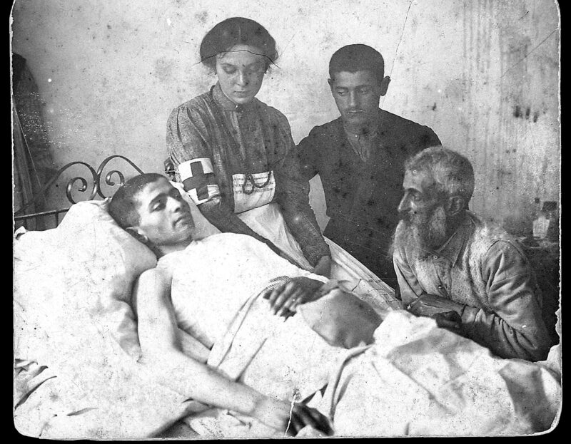 Hannah Weiss with pogrom victim and his family members.