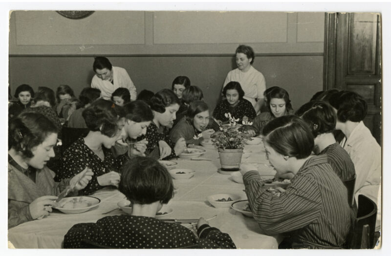 Girls eating in Auerbach Jewish Orphanage